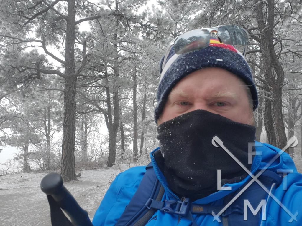 The Frostbit stage of the Hiking Seasons as displayed as a very miserable Fatman hiking in the snow and wind.