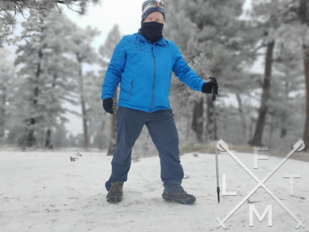 Me on a snow covered trail with my mask and hat covered with blown snow.  Sometimes the challenge is an important part of the mental health benefits of hiking