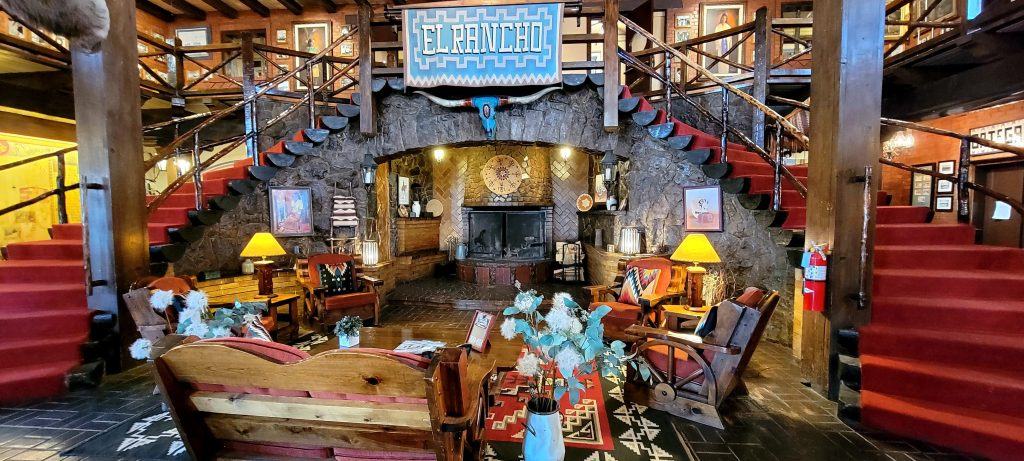 In Response to the interview with an adventurer portion of the Outstanding Blogger nomination the inside of the El Rancho hotel with duel spiral staircases in front of a wonderful wood fireplace.